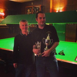 Matt collecting his trophy from the boss, Mark